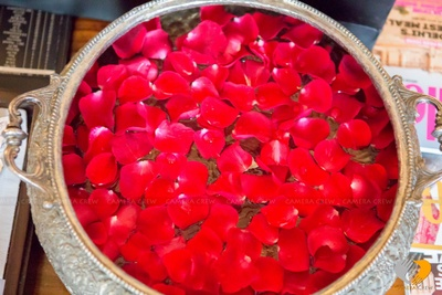 Rose petals adorned in a antique brass pot