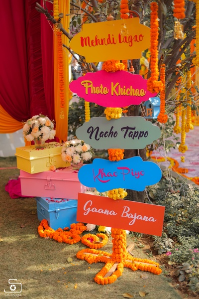 Vibrant and quirky signages as part of the mehendi ceremony decor!