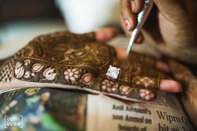 close up of the bride intricate mehendi designs