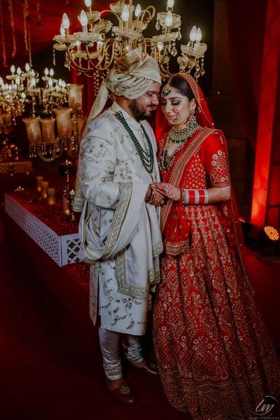 The happy couple striking romantic pose.