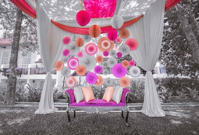 Mindblowing decor with simple paper fans placed innovatively to make the backdrop