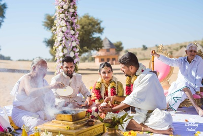 The bride and groom performing rituals as part of the wedding.