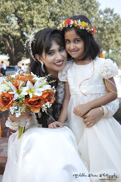 White and orange themed wedding celebrations