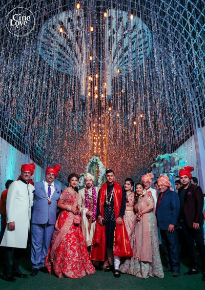 A family picture clicked with the newlyweds. Not to miss the amazing decor!