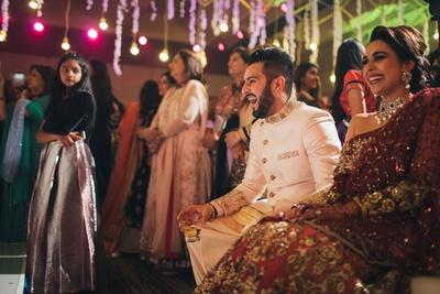 Bride and groom enjoying the sangeet ceremony