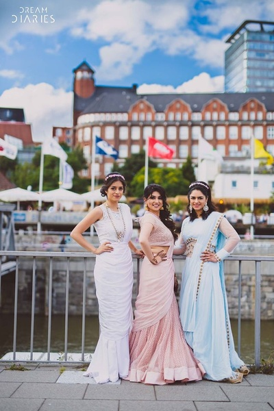 Bride and bridesmaids dressed up elegantly in pastel colours for the mehendi ceremony.