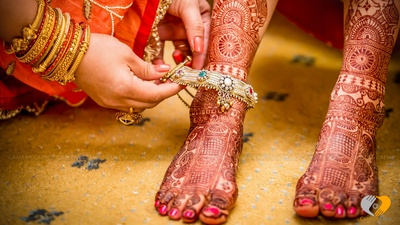 Intricate and detailed bridal mehendi designs adorned with an ethnic anklet
