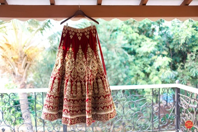Red and gold regal lehenga for the wedding ceremony.