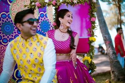 Bride and groom enter the mehndi function on a decorated rickshaw
