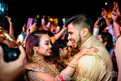 The bride and groom having a gala time dancing at their haldi ceremony.