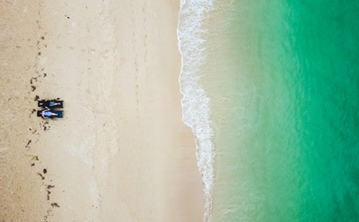 We are in love with this drone shot of the couple's pre-wedding shoot on the beach!