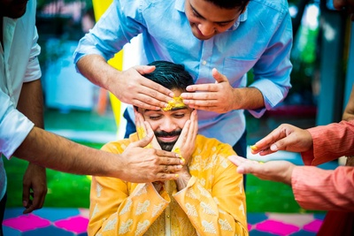 candid expressions of the groom for the haldi ceremony