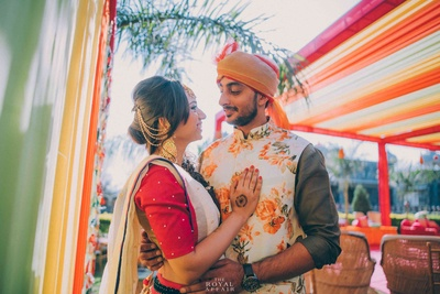 Love is in the air with this cute couple, with the groom wearing Tarun Tahiliani