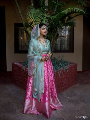 272a29558c Tanvi chose to wear a Benarasi lehenga in fuschia pink with a blue Benarasi  choli