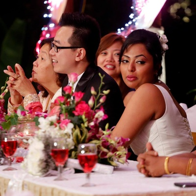 Dinning table decorated with floral bouquets made with Orchids and red Roses