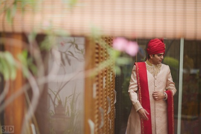 Vinay all dressed up in beige Sherwani styled with red dupatta and red turban for the wedding day.
