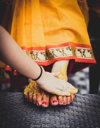 Applying haldi to the bride.