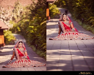 Minimal jewellery styled with the red wedding lehenga, is making the bride look stunning