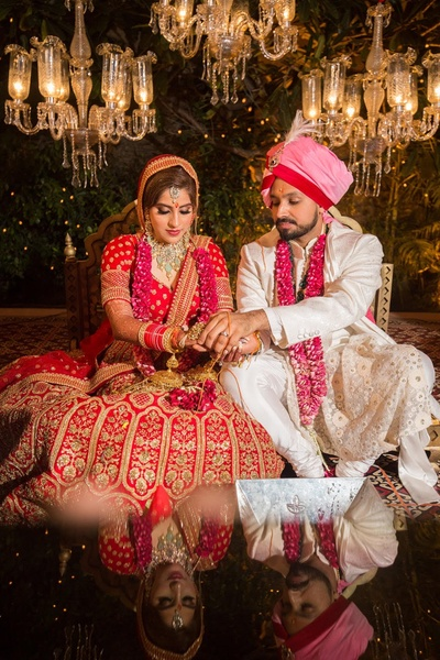 The bride and groom performing rituals at the wedding ceremony.