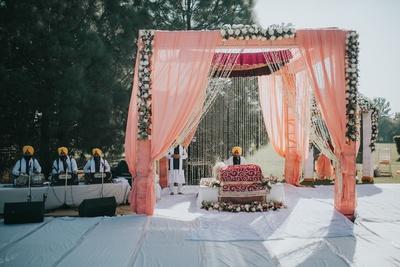 A gorgeous pastel mandap set up for the Anand Karaj ceremony.