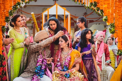 Wedding ceremony with beautiful genda decor.