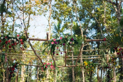 outdoor decor with natural flowers and bamboo sticks