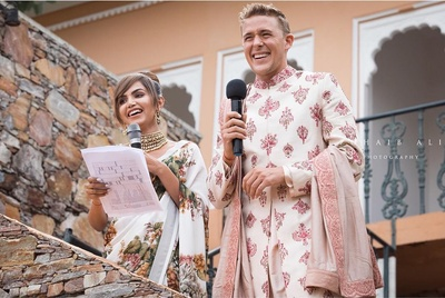 bride and groom addressing the guests on their mehndi ceremony