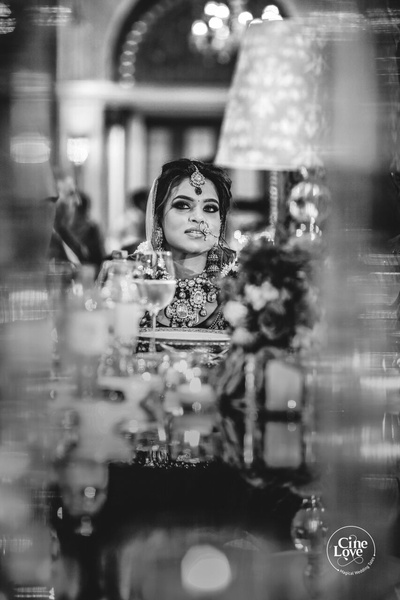 Candid black and white picture of the bride