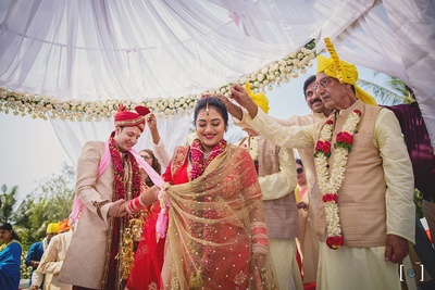Blessings by the elders as the couple take their pheras