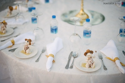 Outdoor table setting with shell like arrangement for beach side wedding celebrations