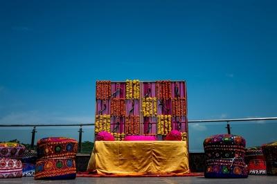 genda phool and pink drapes decor for the haldi ceremony