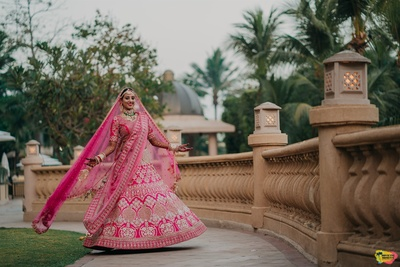 the twirling bride in a fuschia pink bridal lehenga