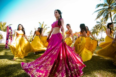 Bride twirling with her bridesmaids during the mehndi function at The Lalit Golf and Spa Resort, Goa