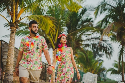 The couple in floral outfits for the Hawain nights