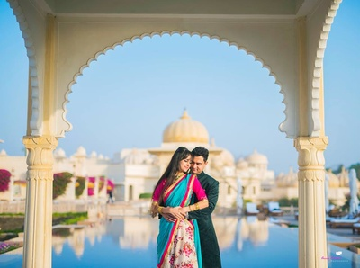 Bride in the fusion of plain  silk and printed georgette saree with golden borders in a an afternoon pre wedding shoot
