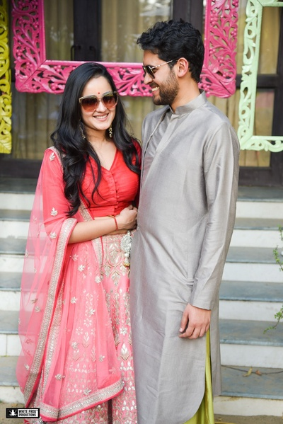 Akriti wore a pastel pink lehenga paired with a reddish pink blouse for her mehendi ceremony.