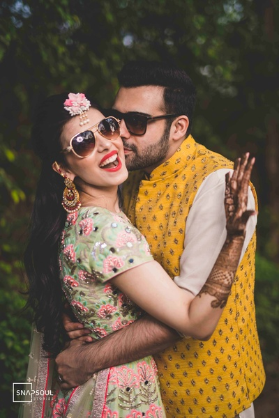 Drool-worthy click of this adorable couple at their mehendi ceremony!