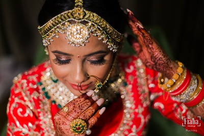 The bride is getting ready and dressed up for her wedding ceremony