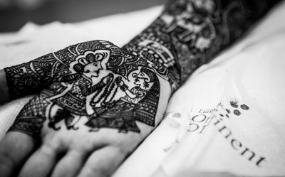 Intricately designed imprints of the bride and groom on bride's palms