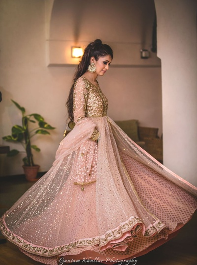Dressed up in a peach and gold anarkali for engagement ceremony.