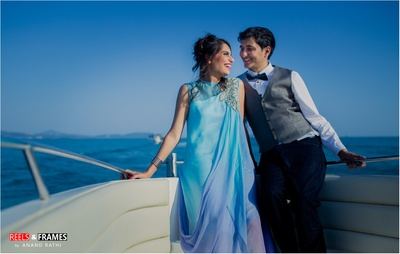 Love how the aqua shades worn by the couple complement the serene blue background