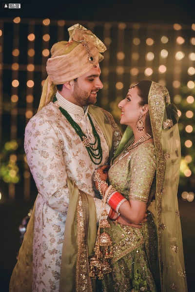 The newlyweds look absolutely spectacular- the bride in her pretty mint green and the groom in his white sherwani!