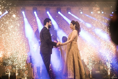 Bride and groom dance together during the sangeet function at Amer Greens, Bhopal
