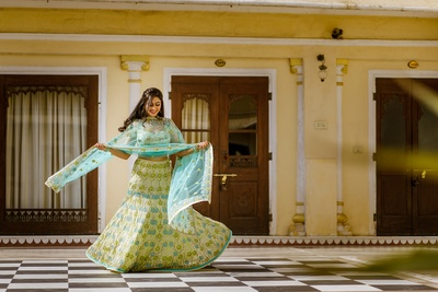 The bride twirling in her blue lehenga