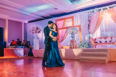 Bride and groom dance together during their reception in Pattaya, Thailand