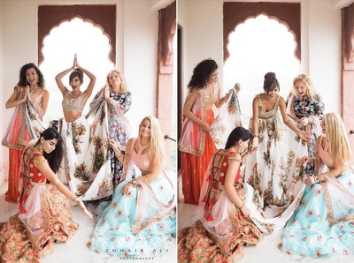 bride and the bridesmaids having fun while getting ready for mehndi ceremony
