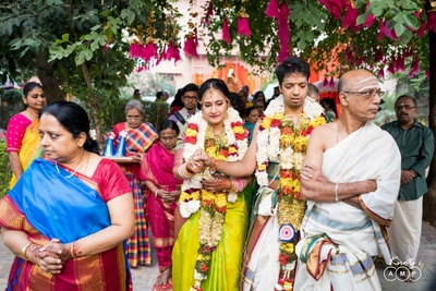 The bride and groom walking towards their wedding mnadap.