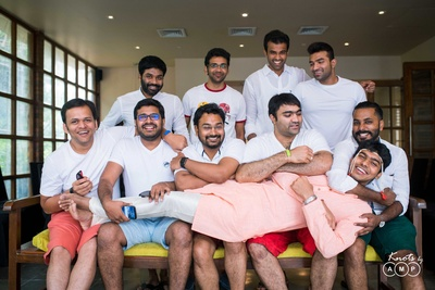 Groom and groomsmen during a quirky pre wedding photoshoot