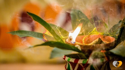 Diya offering for the wedding ceremony with a colorful pot