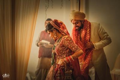 Bride and Groom in the wedding mandap taking the saat pheras